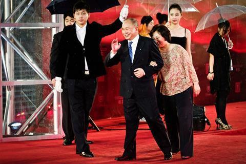 Director John Woo and wife Annie Woo